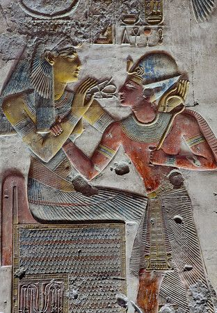"'Seti and Iousas at Abydos.'    	The goddess Iousas is giving pharaoh Seti I the breath of life, in the form of an ""ankh"""
