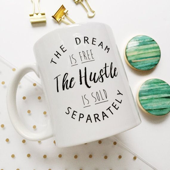 The Dream is Free, The Hustle is Sold Separately. This ceramic coffee mug features motivational modern typography, that is perfect to hold your morning coffee or tea.
