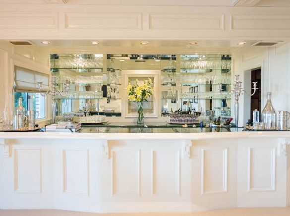 An All White Home Bar That Is Fully Stocked