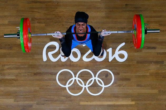 Ayesha Shahriyar M. Albalooshi of United Arab Emirates competes during the Women's 58kg Group B weightlifting contest on Day 3 of the Rio 2016 Olympic Games at the Riocentro - Pavilion 2 on Aug. 8, 2016. | Best Photos From The Rio Olympics