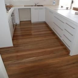 Spotted gum floor with modern poly kitchen