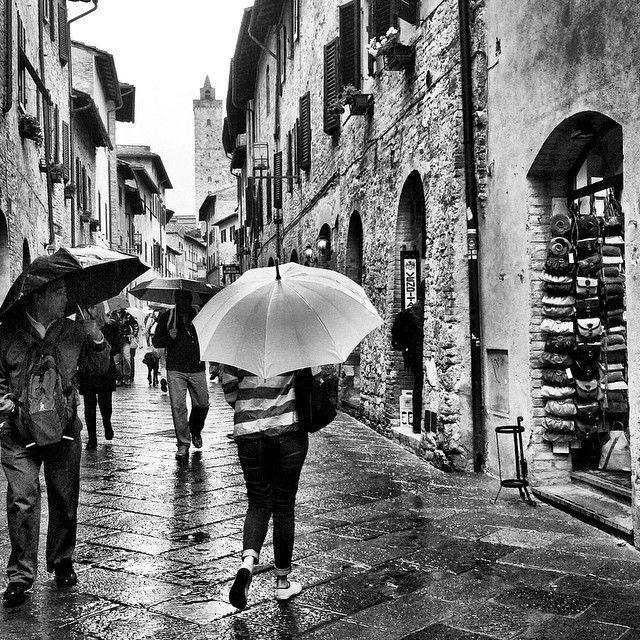 It's rare that you'll find black and white photos in our feed, but with the weather gods against us, and as we're in the step-back-in-time town of San Gimignano, it seemed quite fitting. Find us on Instagram: https://instagram.com/livesharetravel/