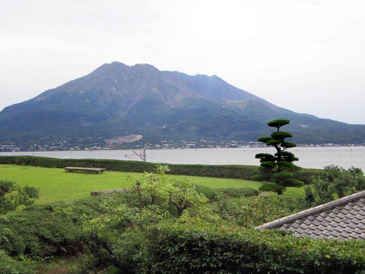 """The Sangen-en Garden in Kagoshima on Kyushu Island, Japan, incorporates views of Sakurajima, an active volcano, a technique known as """"borrowed scenery""""."""