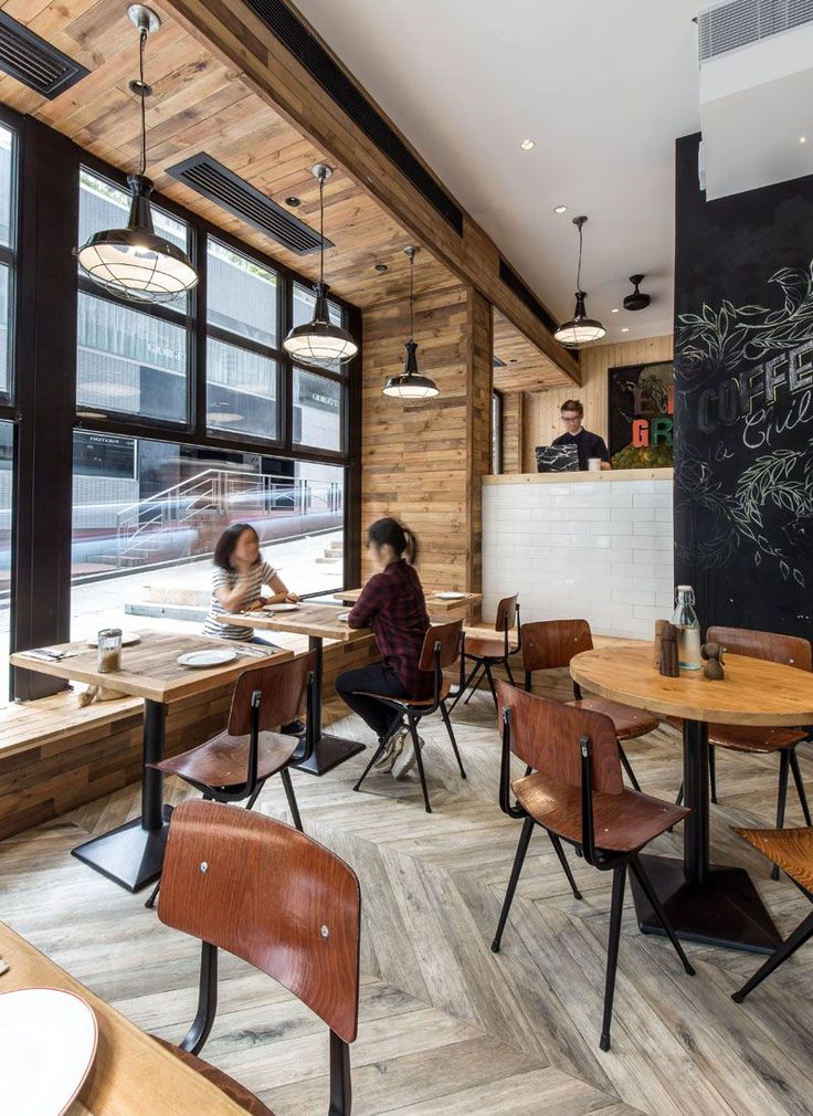 Black details contrast the wood and white details used throughout this coffee…
