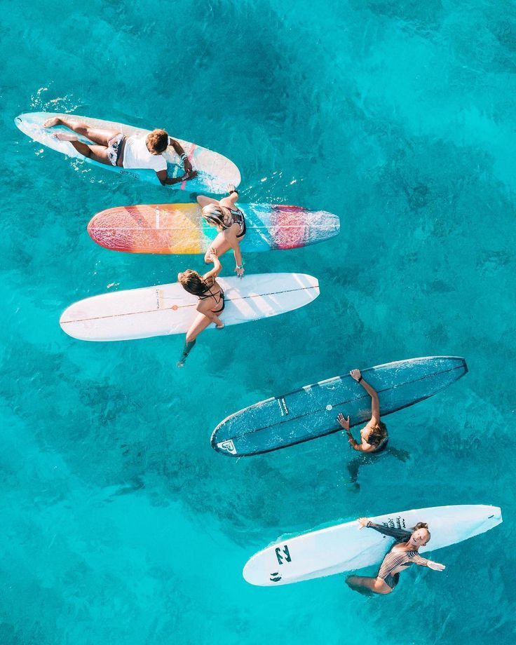 Surfing board in clear water. paddling adventure
