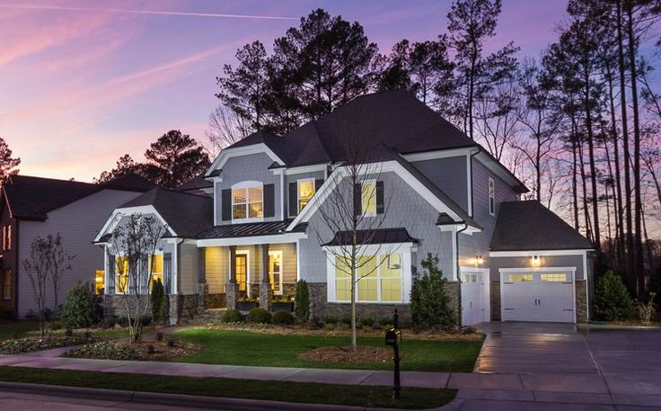 Stone accents and timeless style define the Monterey plan, a new home by Standard Pacific Homes at The Manors At Salem Village. Apex, NC. Learn more at www.NewHomeSource.TV.