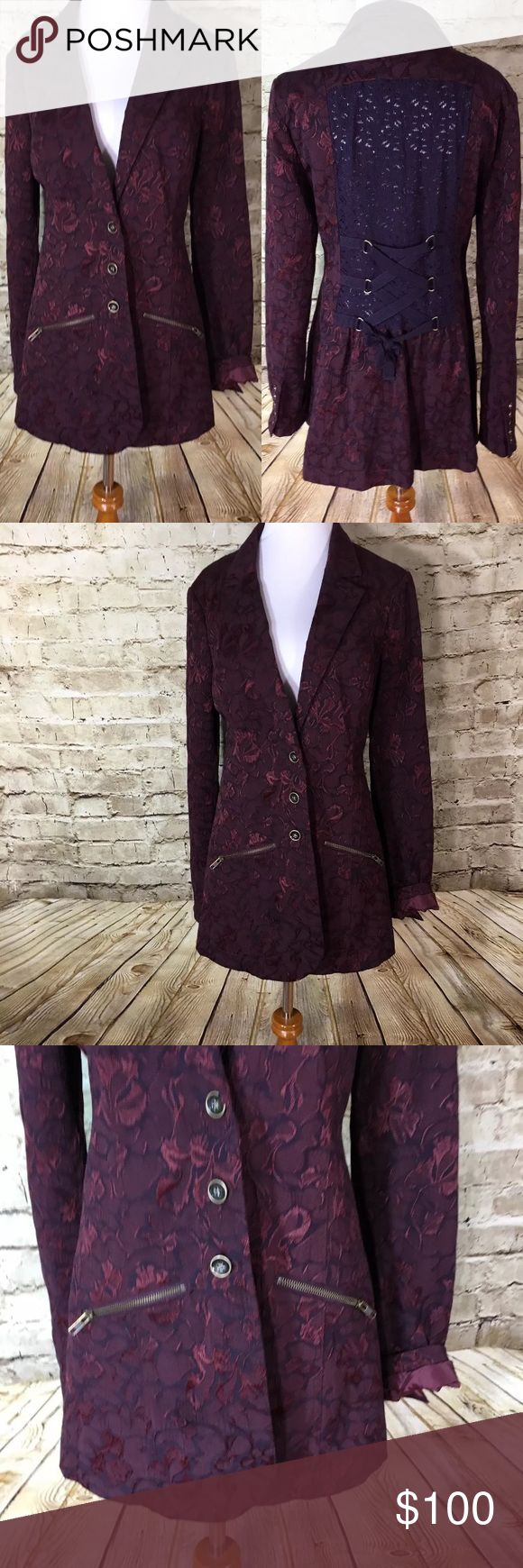 """Free People Jacquard Brocade Jacket Victorian Name Brand: Free People  Condition: Pre Owned, Excellent condition light wear, no holes, stains or flaws to note  Size: 8 (see measurements)  Color: Burgundy   Style: Button Front Blazer Style Jacket With Lace Back and Ties. Front Pockets.  Material: 49% Cotton 49% Polyester 2% Spandex  Always check the measurements, label sizes are not consistent.   Measurements are approximate, and are of item laying flat and unstreched: Waist:17 """" Length:31 """"…"""