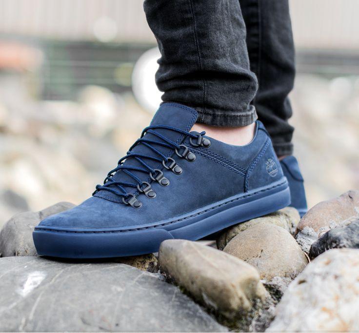 Sportieve, blauwe schoenen met veters zoals je die kent van Timberland.