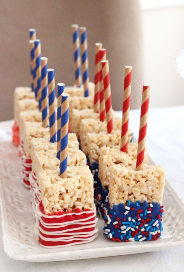 A foodie DIY for your 4th of July Party! Star spangled chocolate dipped rice krispie treat pops made with straws and sprinkles. Easy peasy for kids and grownups to make for a party. Hooray!