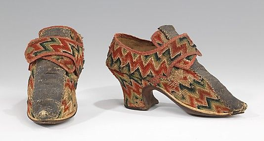 Shoes Date: 1700–1729 Culture: British Medium: wool, linen, metal Dimensions: 4 x 8 1/2 in. (10.2 x 21.6 cm) Credit Line: Brooklyn Museum Co... Accession Number: 2009.300.1411a, b