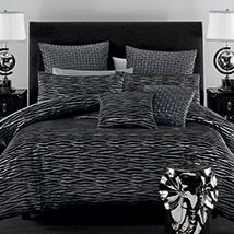 A modern twist on the traditional animal print, Zaria brings the beauty and mystique of the African veldt to the bedroom with a striking black and silver jacquard fabric. This contemporary and unusual approach has created a bold and daring design that will provide a stylish centrepiece for the bedroom.