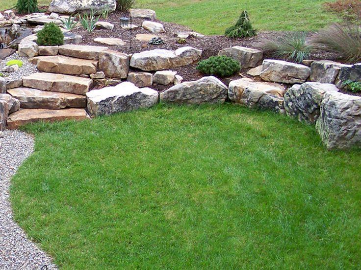 boulder retaining wall creating planting pockets, fieldstone slab steps
