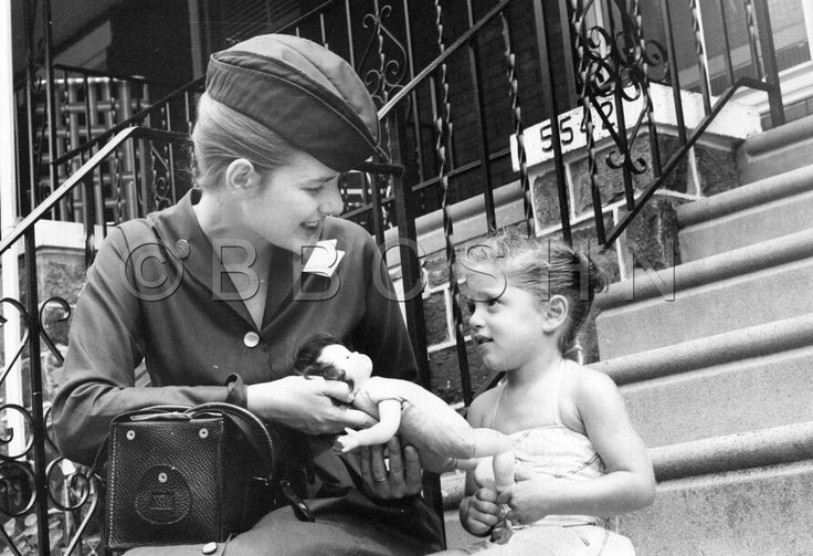 Child, age 3, shows Visiting Nurse Pera her sick doll and asks her to make it better, Community Nursing Services of Philadelphia, c. 1964. Image courtesy of the Barbara Bates Center for the Study of the History of Nursing.