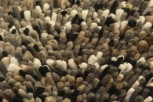 Ik hou van een hoogpolig tapijt omdat het lekker zacht is.
