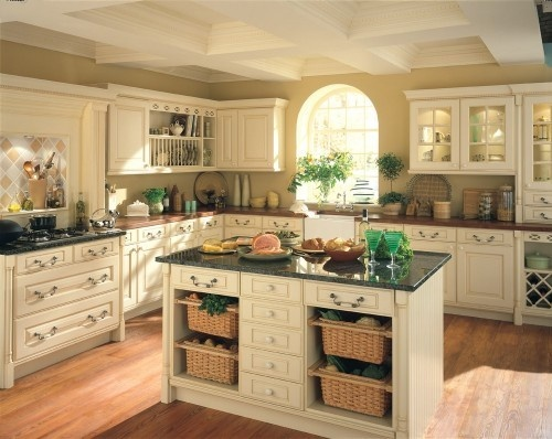 Creamed color kitchen Cream color cabinets, darl counters and cherry wood bamboo floor:)