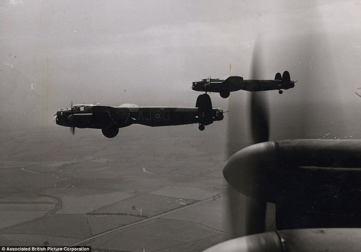 Famous film: A scene from 1955 movie The Dam Busters - released 12 years after the raid - showing the bouncing bomb suspended from the belly of the Lancaster