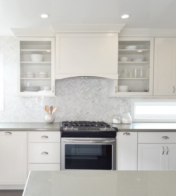 "white and gray modern kitchen remodel | Two suggestions I made with the appliances were to 1) invest in a counter depth refrigerator not a standard 30"" depth so it wouldn't stick out or block the flow of traffic from the other doorway….   counter depth fridge     … and 2) purchase a slide in range with a low profile so that the range controls are on the front and not on a raised back as they are on stand alone versions, that way the backsplash can take the spotlight."