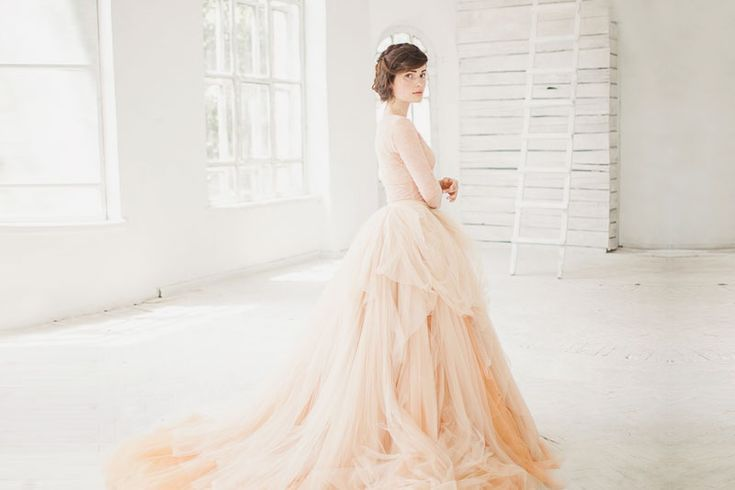 Sweet, feminine, romantic, and refreshing, peach has become one of the hottest trends in recent weddings! The color is a sophisticated blend of both contemporary and classic elegance, making peach dresses a great alternative for traditional gowns. Its soft touch and dreamy tone are perfect for graceful brides. Here are some of our favorite gowns …