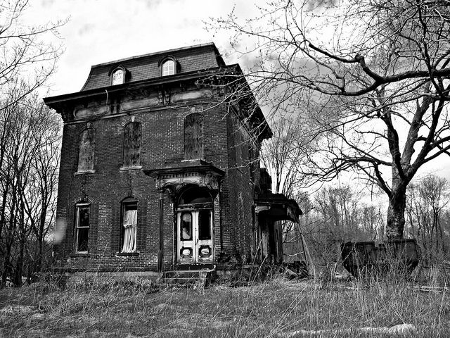 Abandoned mansion and maybe an apparition in Mantua Ohio  A once grand mansard roof mansion now in a state of utter neglect and decay. Built in the 1880s for Mantua banker W.H. Crafts, the structure survives today only on account of its brick construction.