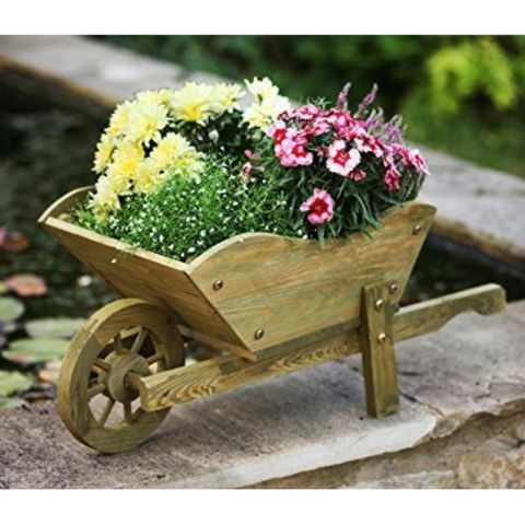 Woodland Wooden Wheelbarrow. www.teeliesfairygarden.com . . . The fairies are so happy to fill this wooden wheelbarrow with flowers to decorate the barn! They are going to have a little farm dance tonight! Isn't it exciting? #fairywheelbarrow