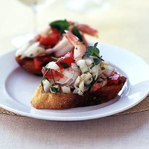 Seafood Bruschetta | This fresh herb and seafood appetizer is lower in calories than most other appetizers. A hit at summer parties.