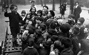 Children from the east end of London holding a meeting to discuss their day in the countryside