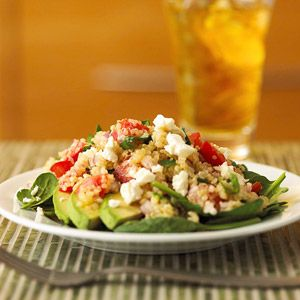 For a meatless main-dish recipe in less than 30 minutes, combine quinoa, avocado, tomatoes, and spinach. The lemon juice mixture adds a refreshing citrus flavor.