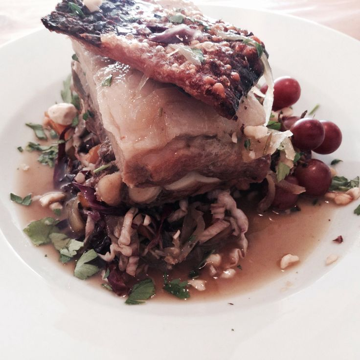 Pancetta di Maiale Roasted porchetta style pork belly, served with crispy crackling, roasted red grapes and toasted hazelnuts