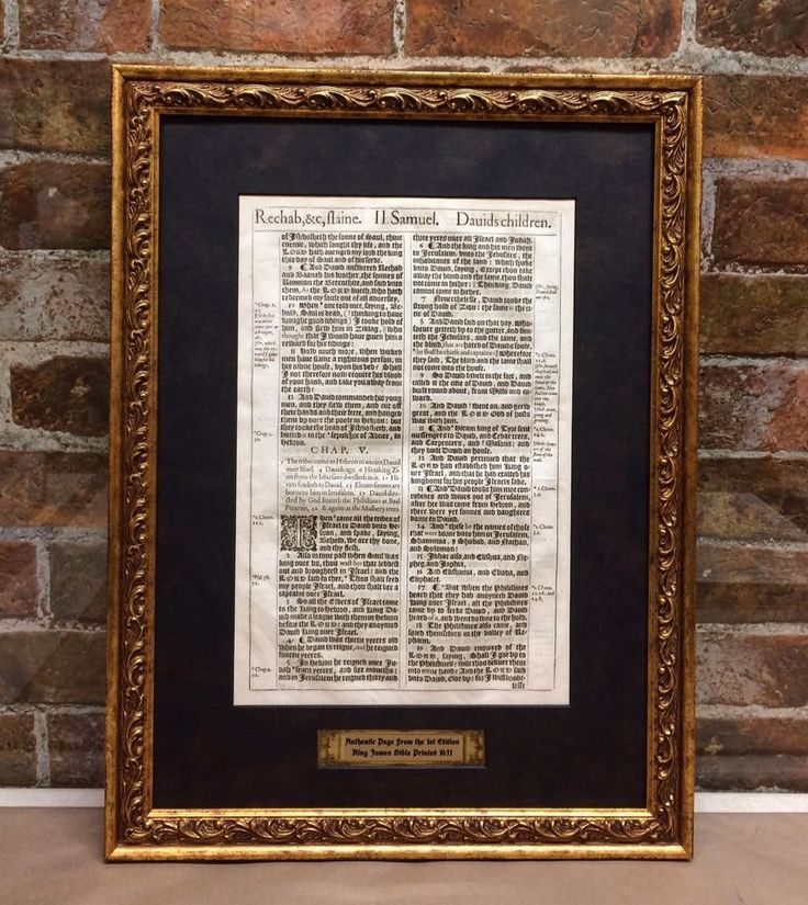 A custom framed page taken from a first edition 1611 King James Bible.
