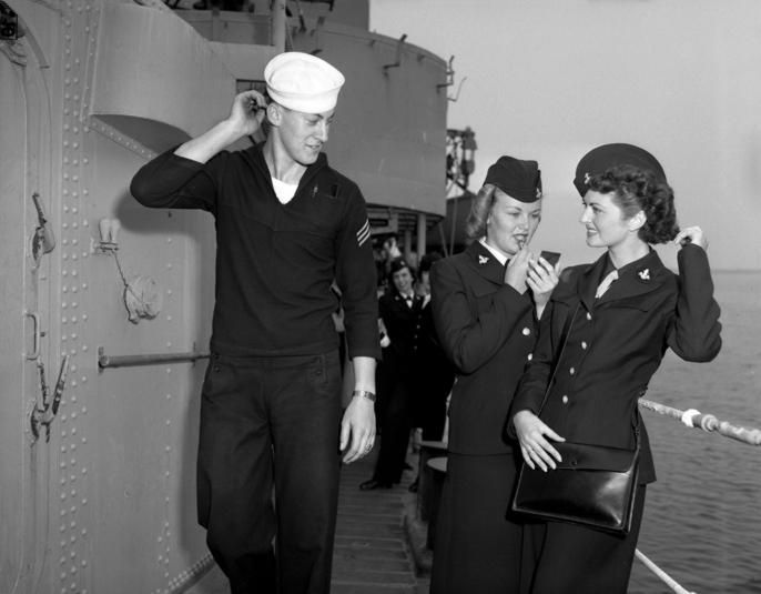 A U.S. Navy sailor and two WAVES (Women Accepted for Volunteer Emergency Service) aboard the Fletcher-class destroyer USS Uhlmann (DD-687) at Terminal Island California. 1950.