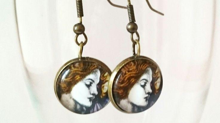 Angel earrings handmade with postage stamps by CraftbyClara on Etsy
