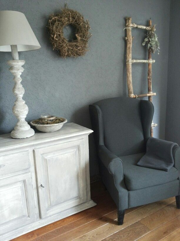 Grey - wood - offwhite, would look nice with a minty-grey color on the wall as well, I think.