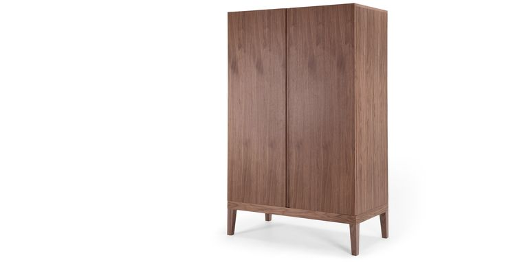 Clean lines, spacious storage and a rich ash veneer makes the Landsdowne Wardrobe in natural walnut an ideal choice for contemporary and classic bedrooms alike.