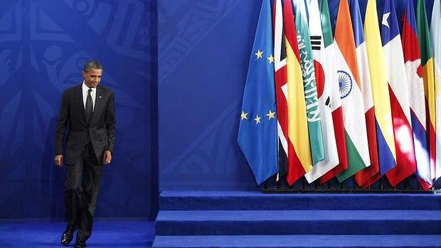 U.S. President Barack Obama arrives for a news conference on the second day of the G20 Summit in Los Cabos, June 19, 2012. REUTERS/Edgard Ga...