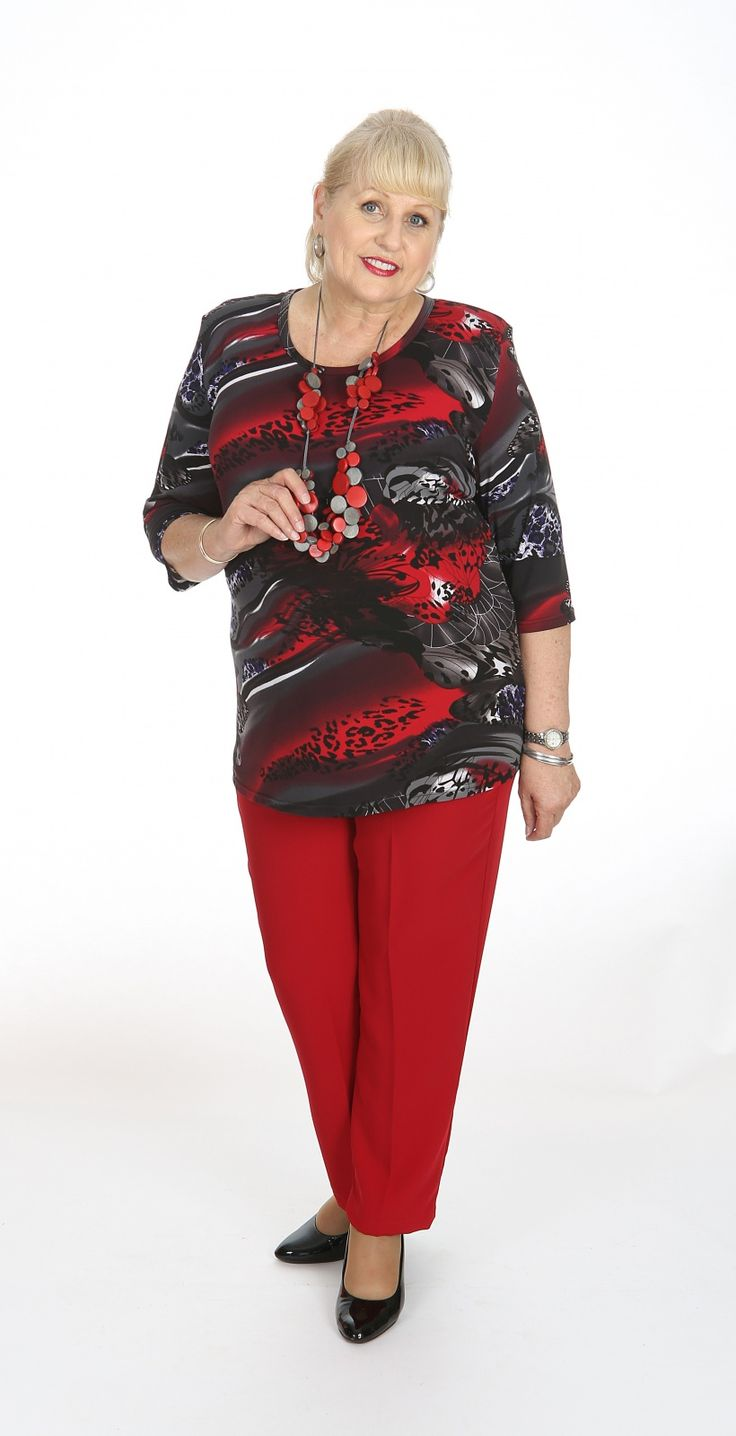 Printed round neck top in red: Our ever popular polyester spandex round neck style in a red and royal print.  Our round neck top are a gentle a-line which is flattering to all figure types. Fabric: Polyester Spandex Label: Lagos