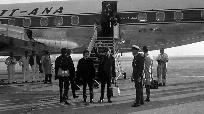 The Beatles arrive at Brisbane's Eagle Farm airport, 1964