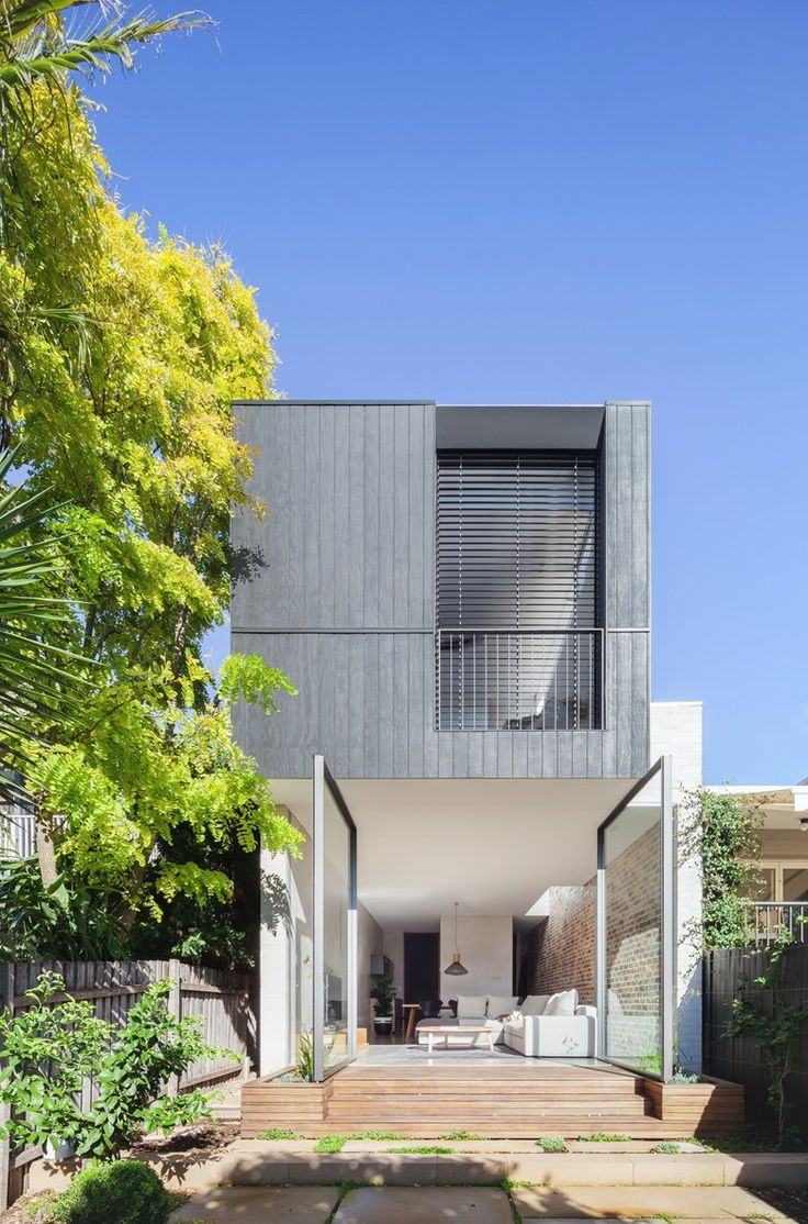 Set within a heritage conservation area, the original semi has been kept in-tact with its roof line restored. A 'breezeway' transition space connects the original house and its new split level contemporary addition, allowing light to...