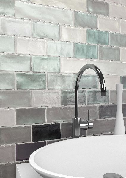 Magna Electra tile is seen on this backsplash. The iridescent quality brings life into the space. #TileofSpain