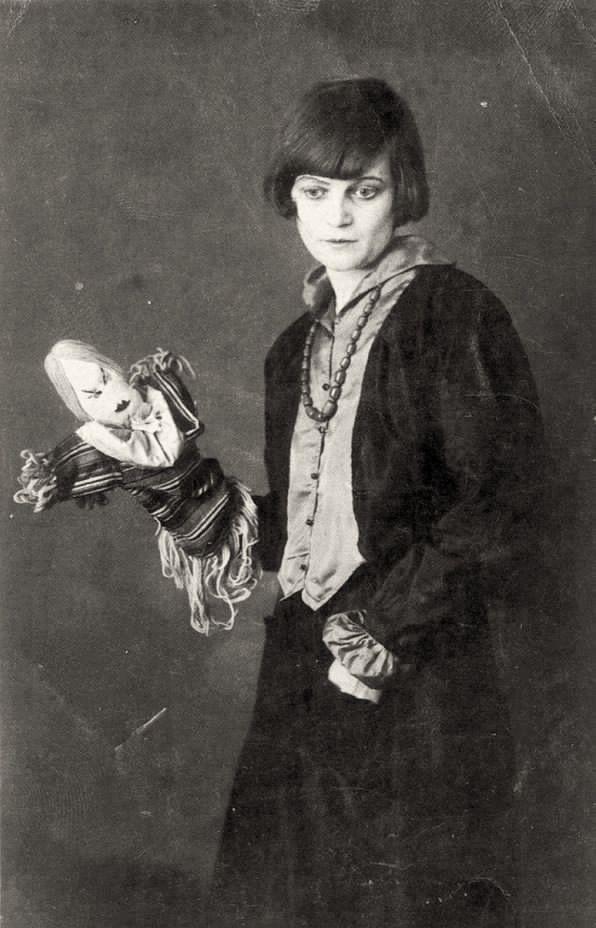 Emmy Hennings with one of her Dada dolls, Zurich, 1917.