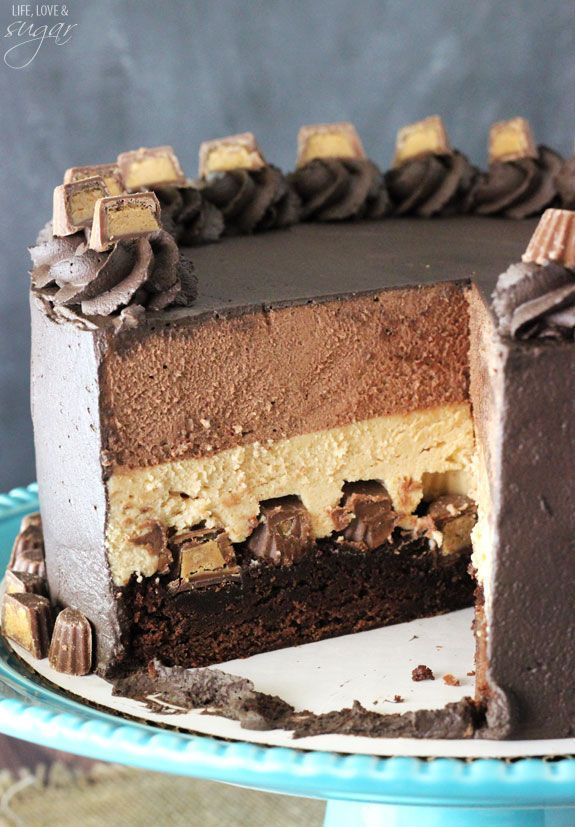 Peanut Butter Chocolate Mousse Cake - A brownie layer on bottom with Reese's, topped with peanut butter and chocolate mousse!