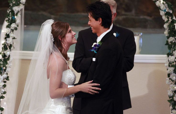 Aurora shooting survivors Kirstin Davis and Eugene Han, during their wedding ceremony at Village East Baptist Church, in Aurora, Colorado, on July 20, 2013. The date -- one year exactly since the shootings -- was chosen by the couple so the anniversary would bring joy in the future, not just painful memories. In 2012, Eugene was shot while trying to protect his longtime girlfriend Kirstin from harm during a shooting rampage in an Aurora theater.