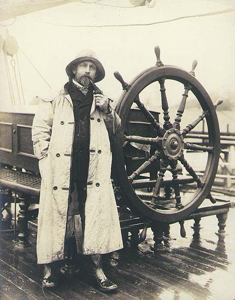 Capt. Alex Teschner beside the wheel of the three-masted German bark PERA, Port Blakely, Washington, 1901. University of Washington Libraries. Special Collections Division.