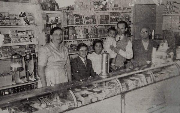 George Poulos, second from right, owner of the Rio milk bar in Summer Hill, with his family circa 1960