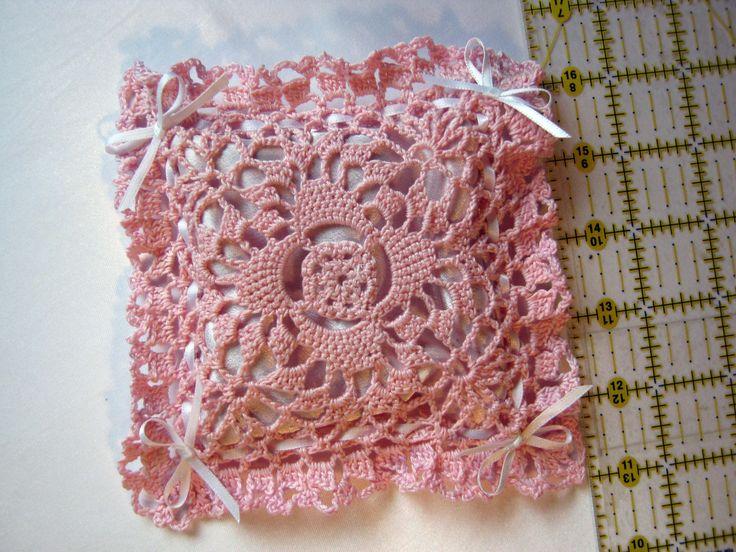 Satin-lined crochet lavender sachet.