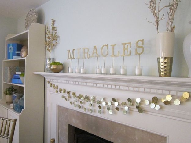 String a gelt garland for some extra shimmer. / 21 Super Cute Ways To Decorate For Hanukkah (via BuzzFeed)