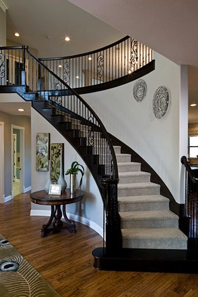 I have the same stair case! Notes to self: Metal wall art along stair case. Round table. Double panel art.