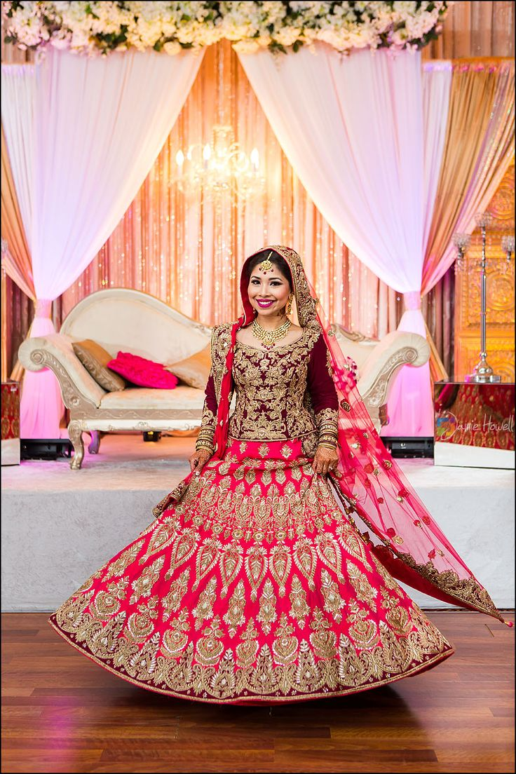 Pretty as a princess! Bengali bride dons a beautiful maroon and hot pink combo lehenga that has her twirling in happiness <3 #bengalibride #indianbride #muslimbride via Jamie Howell Photography