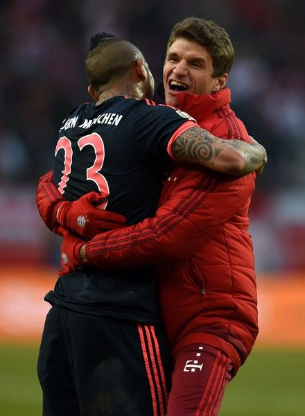 Bayern Munich's Chilean midfielder Arturo Vidal (L) and Bayern Munich's midfielder Thomas Mueller react after the German first division Bundesliga football match FC Cologne vs Bayern Munich in Cologne, western Germany, on March 19, 2016.