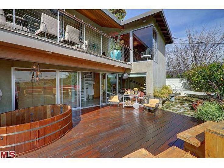"""The mid-century modern at 2732 Hollyridge Dr., Los Angeles, CA 90068 is being called """"an artistic sanctuary."""" The price is $1.269 million and it includes 3 bedrooms and 2 bathrooms over 1,700 square feet. Eva Mendes bought the place for $584,000 back in 2002.  The property is chock full of urban artist/gardner touches, including many separate spaces. The decor is eclectic, with custom wallpaper and carpets. As a bonus, there appears to be a patch of ground perfect for raising chickens."""
