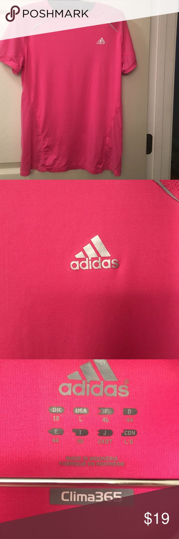 Adidas Clima365 Beautiful pink with  silver logo.   Says USA Large.   One of the logos on the back down under the arm area is peeling off.   Otherwise looks great.         Bundle and save. Adidas Tops Tees - Short Sleeve